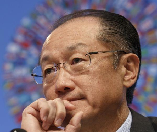 World Bank President Jim Yong Kim listens during a news conference at IMF Headquarters.