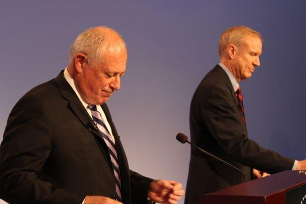 Governor Pat Quinn and Republican challenger Bruce Rauner gather themselves before their debate in Peoria Thursday night.