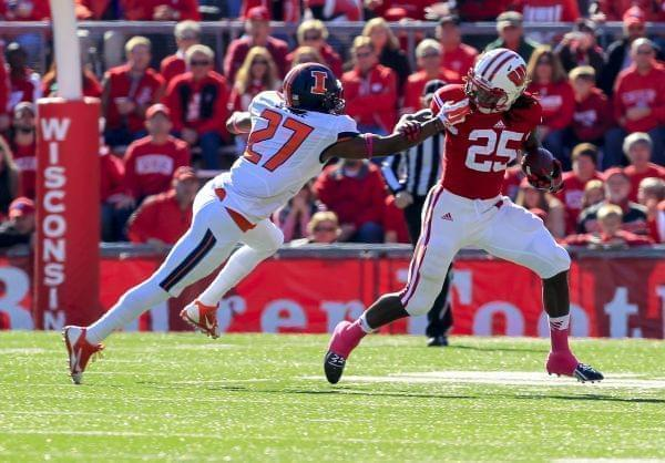 Illini Eaton Spence pulls on Wisconsin's Melvin Gordon during Saturday's loss.