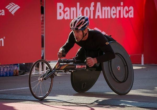 Joshua George crosses the finish line to win the men's wheelchair race during the Chicago Marathon on Sunday, Oct. 12, 2014, in Chicago.