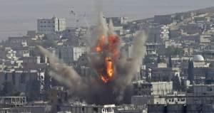Smoke rises after a US coalition airstrike in the city of Kobani Monday.