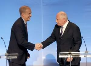 Pat Quinn and Bruce Rauner greet before a debate in Chicago Tuesday.