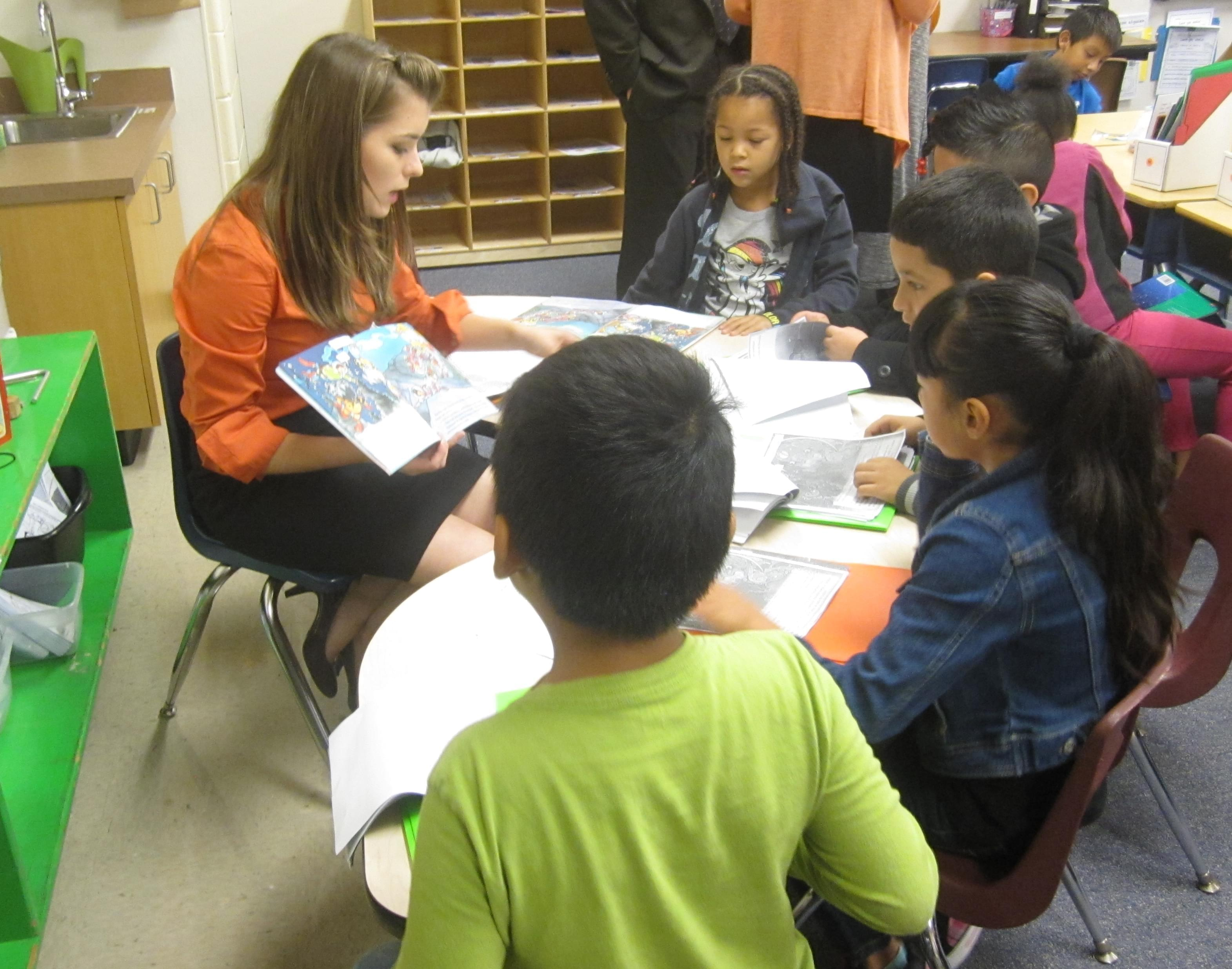 Teacher Kelsey Schoenecke goes through a book with 2nd graders in a dual language immersion class at Urbana's Prairie School.
