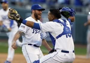 Relief pitcher Greg Holland and catcher Salvador Perez celebrate after the Kansas City Royals defeat Baltimore 2-1 in Game 4 of the AL championship series.