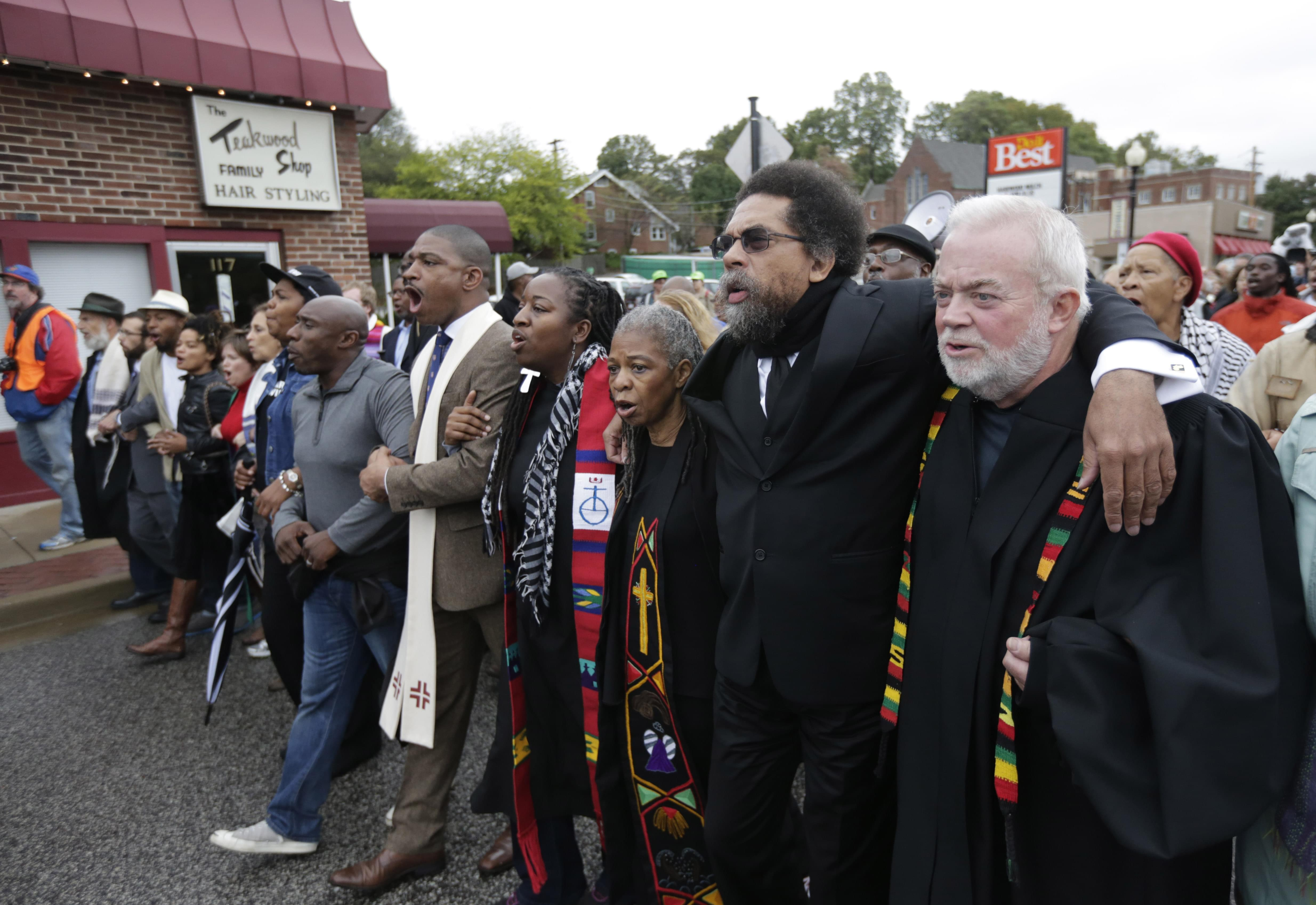 Protesters march to the Ferguson Police Station October 13.