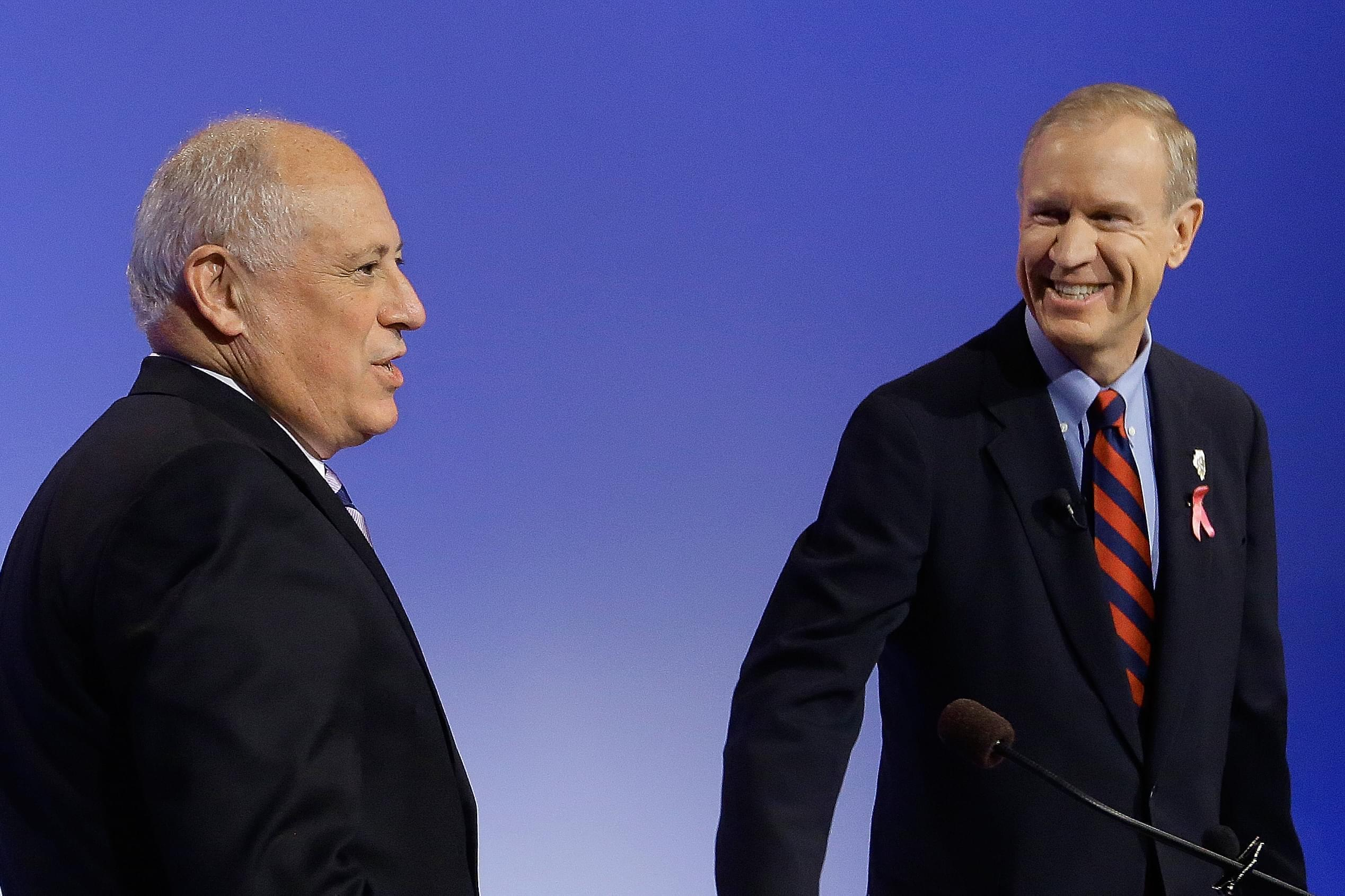 Governor Pat Quinn prepares to debate challenger Bruce Rauner.