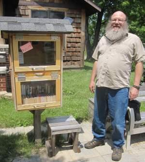 Mike Lehman and his nuz/box, outside his home in Urbana.
