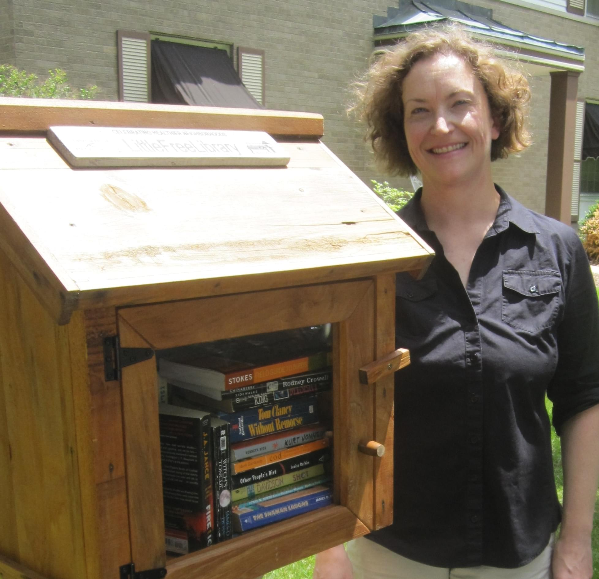 Cara Finnegan stands by her Little Free Library in Champaign.
