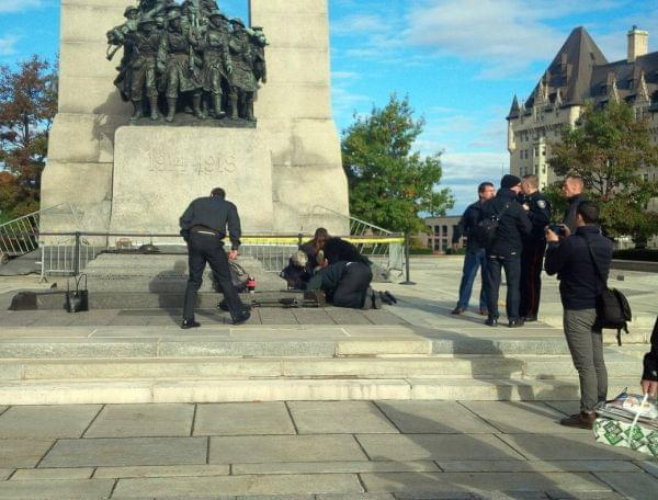 A Canadian soldier shot outside the war memorial in Ottawa is tended to Wednesday.