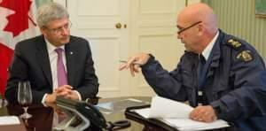 Canadian prime Minister Stephen Harper being briefed by RCMP head Bob Paulson on the Parliament Hill shootings.