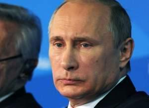 Vladimir Putin attends a conference of political experts in Sochi, Russia.