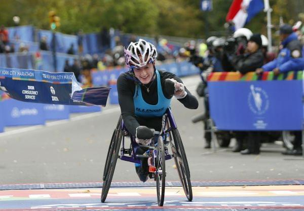 Tatyana McFadden reacts as she breaks the tape after finishing first in the women's wheelchair racing division in New York Sunday.