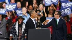 President Obama stands with Connecticut Governor Dan Malloy in Bridgeport Sunday.