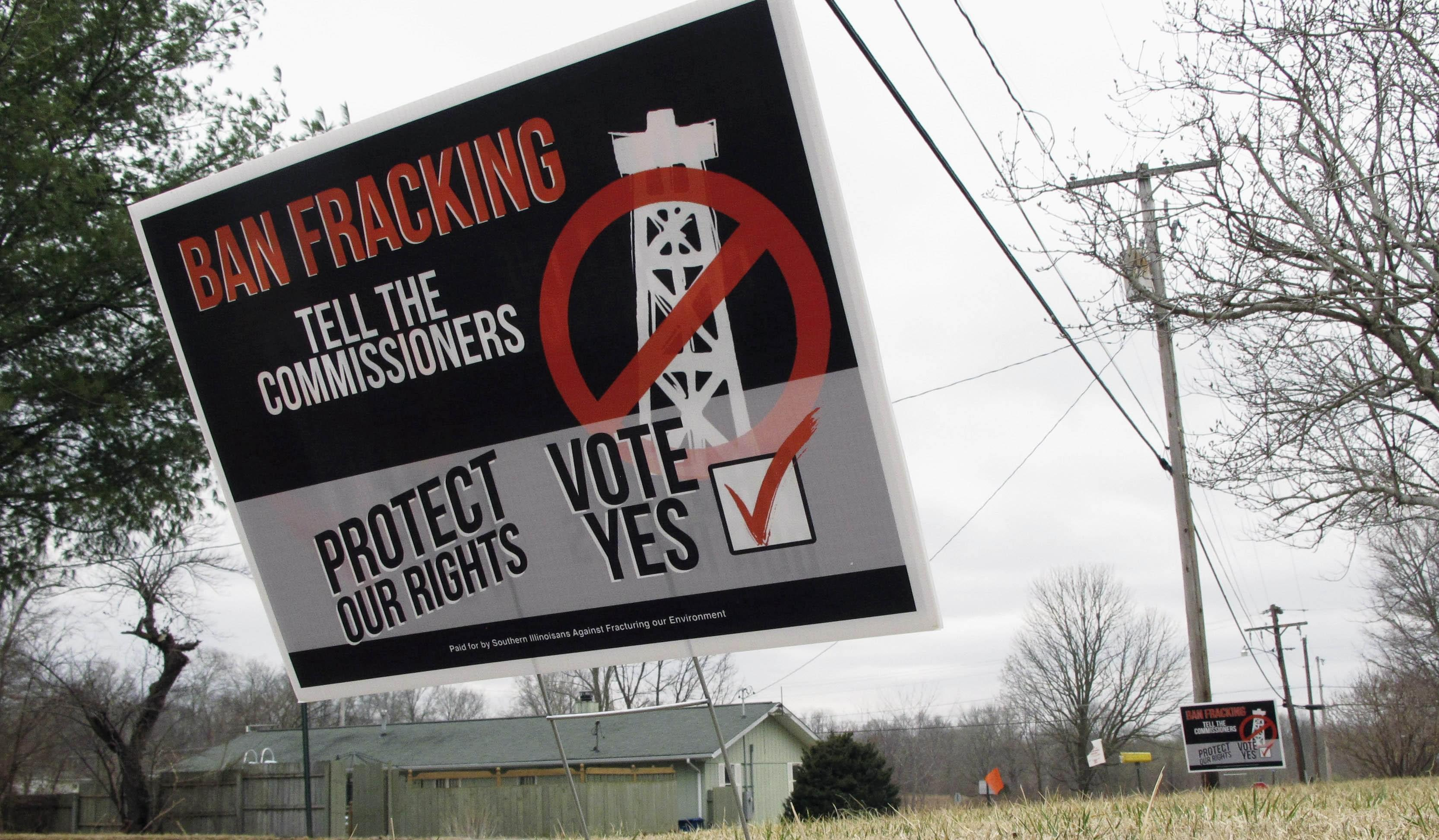A sign near the Johnson County courthouse urges county voters to defeat a referendum on fracking.