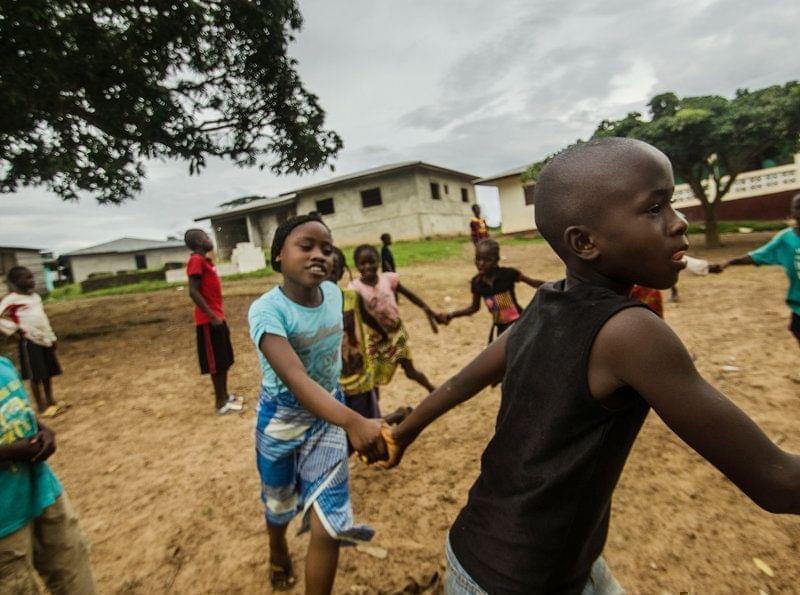 Children play in an open space in Barkedu, Liberia.