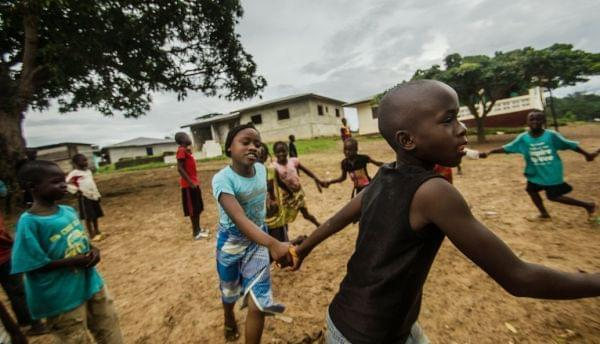 Children play in an open space in Barkedu, Liberia.