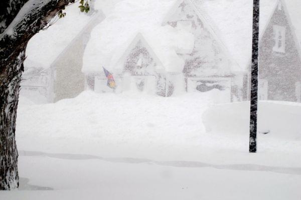 A house is obscured by lake effect snow Tuesday.