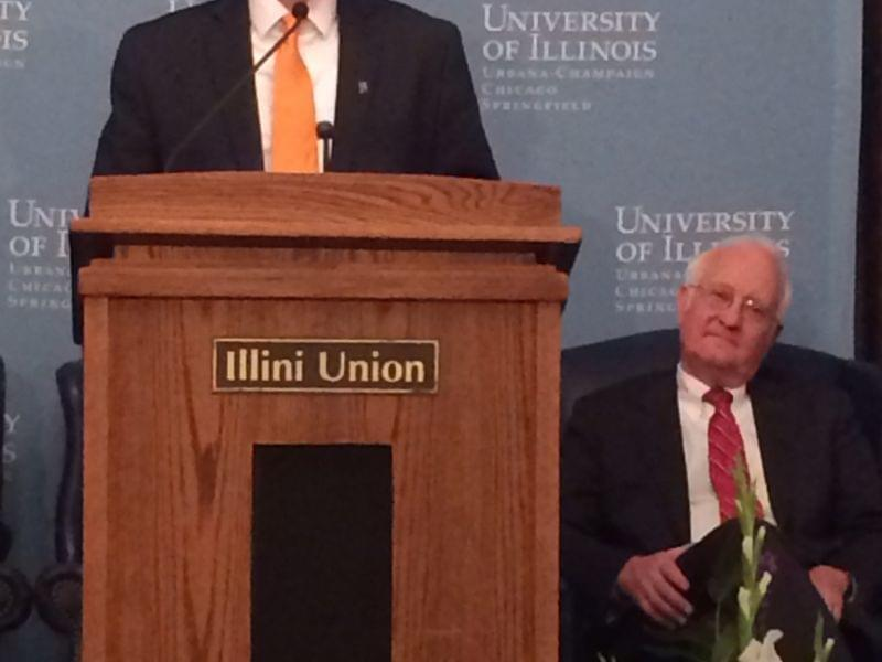 Incoming University of Illinois President Timothy Killeen addresses the Urbana campus at the Illini Union on Wednesday as outgoing President Bob Easter looks on.