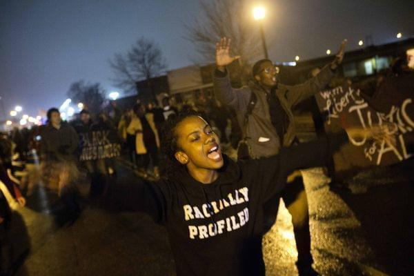 Brittany Ferrell chants while marching through the streets of St. Louis protesting the August shooting of Michael Brown.