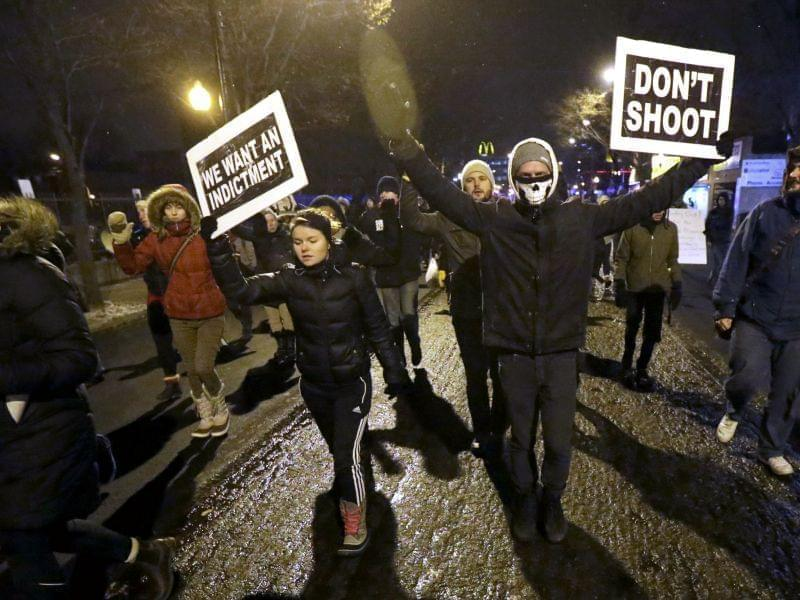 Protesters march during a rally near Chicago Police headquarters Monday night.