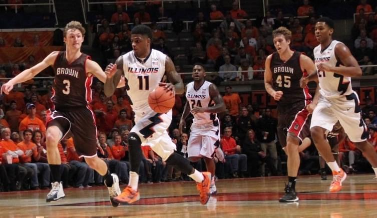 Aaron Cosby dribbles down court against Brown Monday at the State Farm Center.