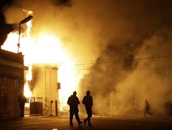 A storage facility in Ferguson, MO, burns after a grand jury ruled against filing charges against Ofc. Darren Wilson.