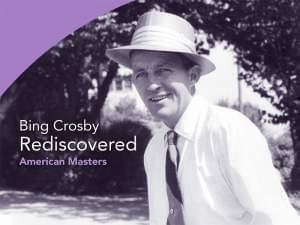 Photo of Bing Crosby wearing a straw hat