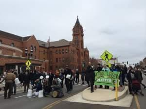 Activists rally outside the Champaign County Courthouse Tuesday in solidarity with those in Ferguson, Missouri.