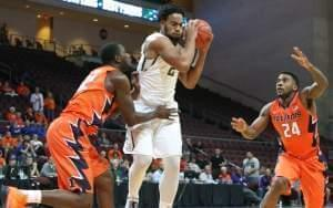 Nnanna Egwu and Rayvonte Rice guard Rico Gathers in Friday's win.