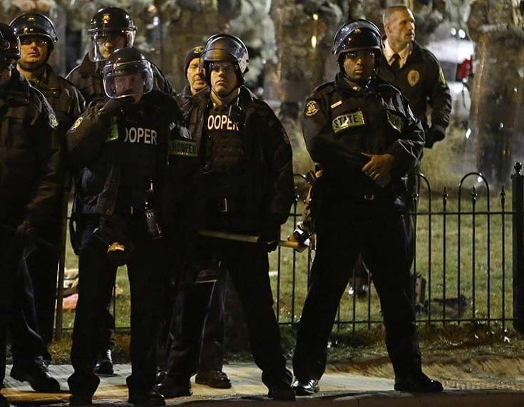 Ferguson Police and Missouri National Guardsman outside the Ferguson Police Department.