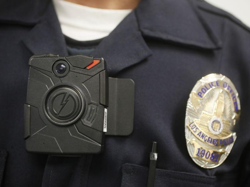A Los Angeles Police officer wears an on-body camera during a demonstration for media.