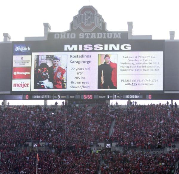 A police poster showing Kosta Karageorge is displayed on the large video board before the state of Ohio State's game Saturday.