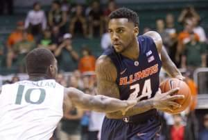 Illini Rayvonte Rice looks for an open teammate past Miami guard Sheldon McClellan.