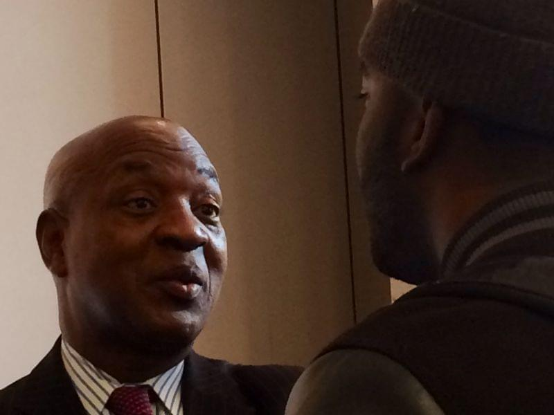 Harvard Law Professor Charles Ogletree speaks with a lecture attendee Wednesday at the U of I.