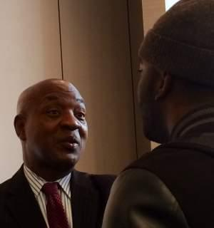 Harvard Law Professor Charles Ogletree speaks with a lecture attendee Wednesday at the U of I