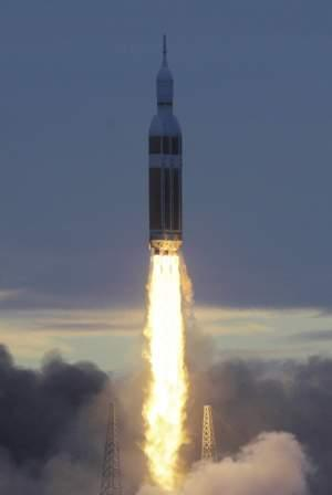 A rocket carrying NASA's Orion space capsule lifts off for its first unmanned orbital test flight at Cape Canaveral, Fla.