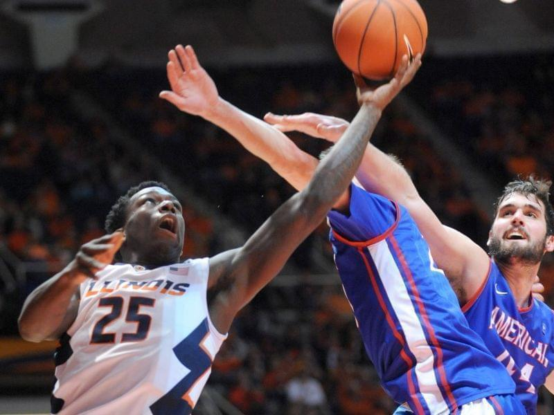 Illinois guard Kendrick Nunn shoots from behind the basket while being guarded by American guard Charlie Jones.