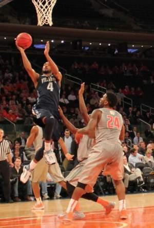 Villanova's Darrun Hilliard scores as Illinois' Rayvonte Rice looks on.