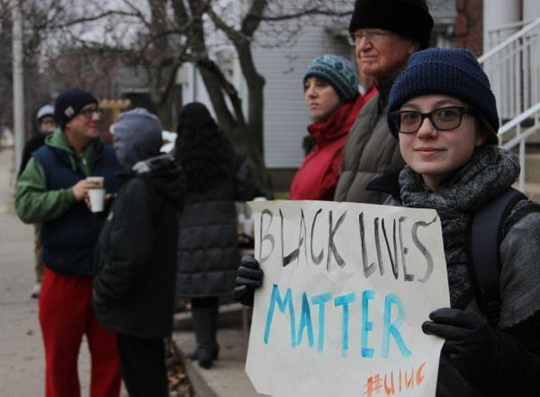 Protesters line Springfield Avenue in Champaign Friday.