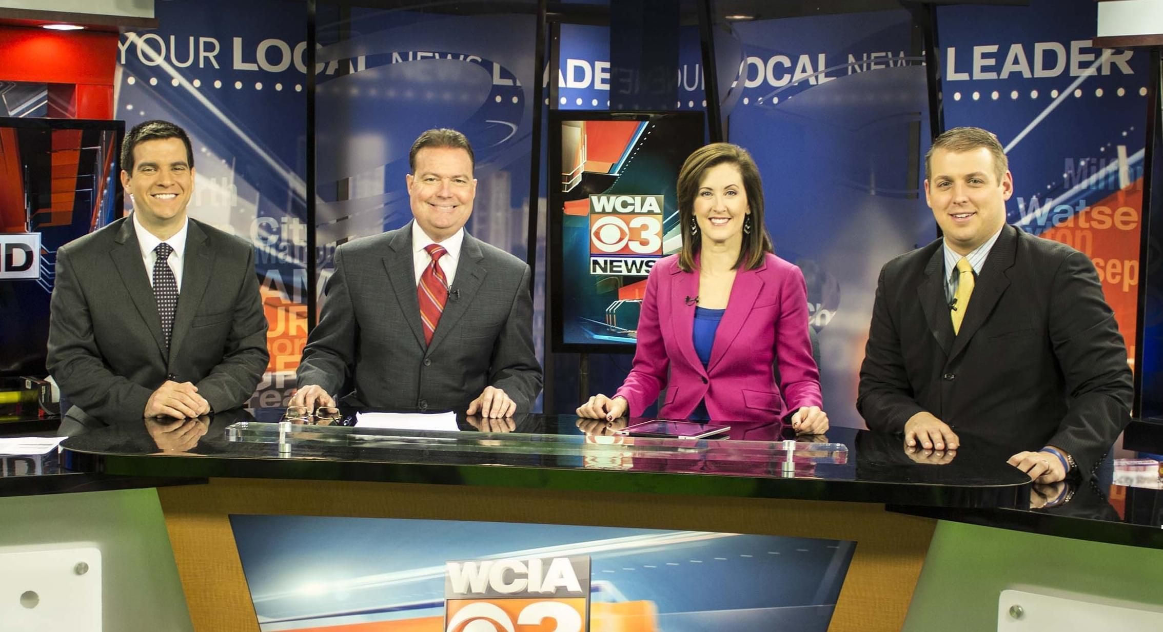 Dave Benton - second from left -and WCIA staff in an evening broadcast.