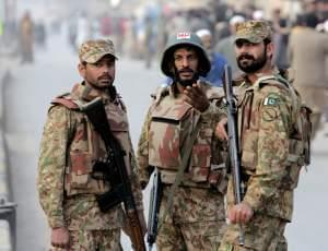 Pakistan army soldiers cordon off the area outside a school attacked by the Taliban in Peshawar.