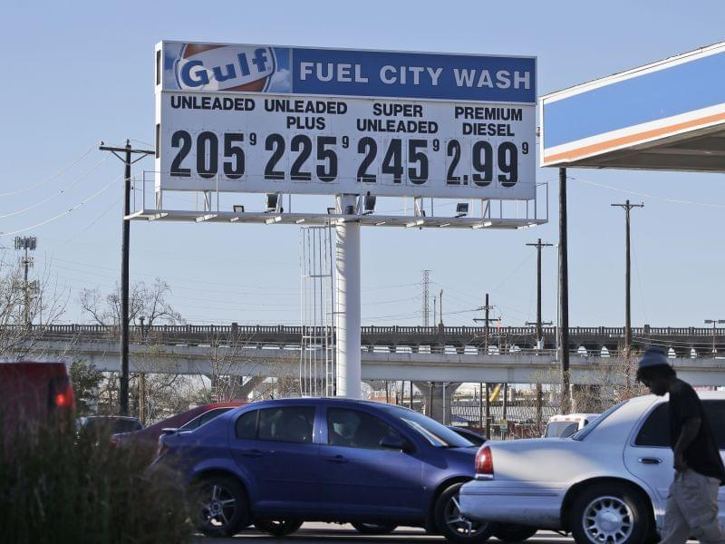 Vehicles line up to take advantage of low gas prices at the Fuel City gas station in Dallas.