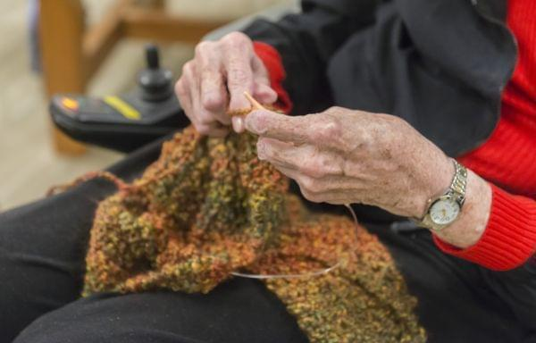 a resident in a nursing home knitting