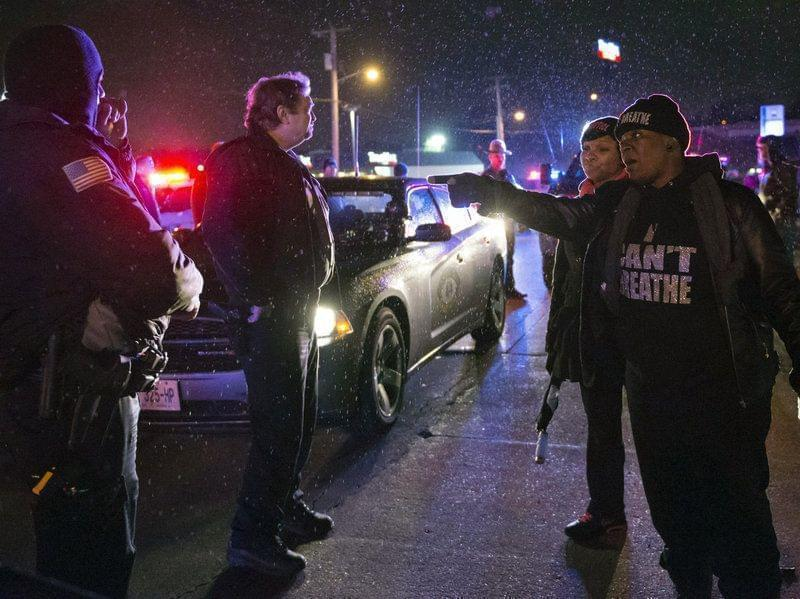 A protester shouts at police in Berkeley on Christmas Eve night.