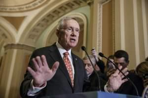 Harry Reid speaks with reporters on December 2nd at the Capitol.