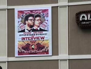 A poster advertising The Interview hangs on the back wall of the Alamo Drafthouse Cinema