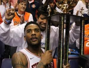 Illinois basketball player Rayvonte Rice, hoisting the Braggin' Rights Trophy with his mother, Rhonda Rice.