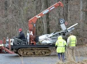 Salvage workers clearing site of plane crash