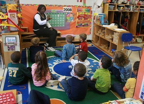 teacher in a classroom with kids