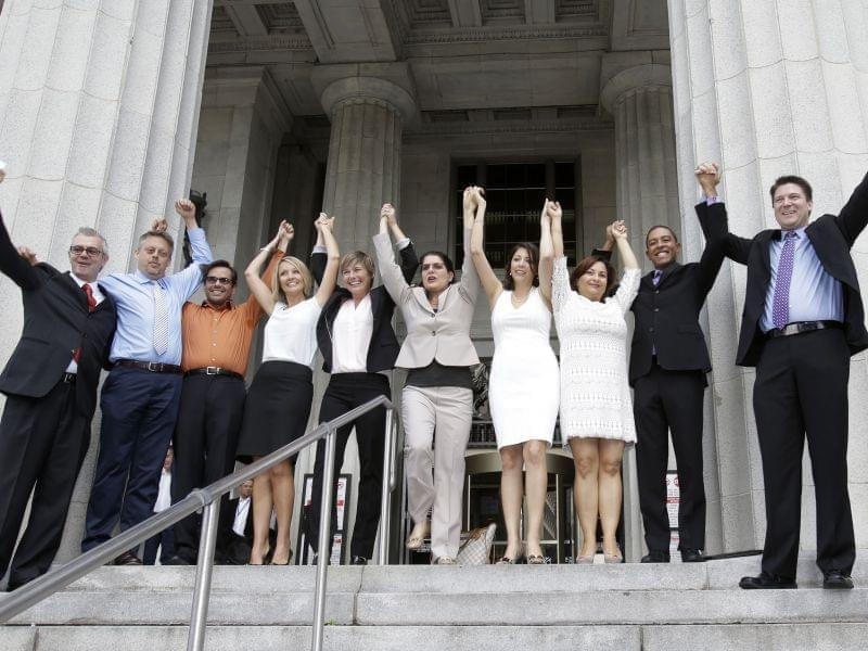 Same-sex couples celebrate on the courthouse steps in Miami-Dade County